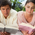 Man and a woman with a serious expression while reading books as they lie prone on a blanket in the  stock photo © wavebreak_media