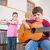 cute pupils playing flute and guitar in classroom stock photo © wavebreak_media