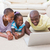 happy smiling couple using laptop with their daughter stock photo © wavebreak_media