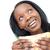 Jolly young woman eating a sandwich  stock photo © wavebreak_media