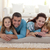 glimlachend · familie · vloer · woonkamer · gezicht · liefde - stockfoto © wavebreak_media
