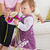 adorable little girl holding flowers in the living room at home stock photo © wavebreak_media