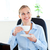 Delighted businesswoman drinking coffee in front of her laptop in her office at her desk stock photo © wavebreak_media