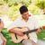 yakışıklı · adam · oynama · gitar · gülümseme · çift · güzellik - stok fotoğraf © wavebreak_media