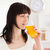 good looking brunette drinking a glass of orange juice while standing in the kitchen stock photo © wavebreak_media