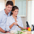 married couple cooking in their kitchen stock photo © wavebreak_media