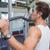 geschikt · man · gewichten · machine · armen · gymnasium - stockfoto © wavebreak_media