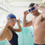 fit couple swimmers by pool at leisure center stock photo © wavebreak_media