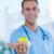 smiling doctor presenting a green apple stock photo © wavebreak_media
