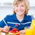 Jolly boy eating waffles with strawberries stock photo © wavebreak_media