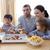 genitori · bambini · mangiare · pizza · patatine · divano - foto d'archivio © wavebreak_media