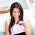 elragadtatott · ázsiai · nő · laptopot · használ · tart · kártya - stock fotó © wavebreak_media
