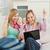 enthousiast · vrouwen · naar · laptop · vergadering · sofa - stockfoto © wavebreak_media