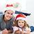 Happy mother and daugher relaxing in the living room at christmas stock photo © wavebreak_media