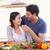 man feeding his girlfriend in their kitchen stock photo © wavebreak_media