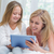 mother and daughter using tablet pc in the bed stock photo © wavebreak_media