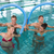 fitness class doing aqua aerobics with foam rollers stock photo © wavebreak_media