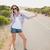 viaje · mujer · feliz · pie · carretera · vacaciones - foto stock © wavebreak_media