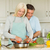happy mature couple making dinner together stock photo © wavebreak_media