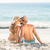 happy couple relaxing together in the sand stock photo © wavebreak_media