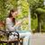 gülen · genç · kadın · oturma · bank · açık · havada · sokak - stok fotoğraf © wavebreak_media