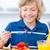 Adorable boy eating waffles with strawberries stock photo © wavebreak_media
