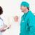 orvosok · megvizsgál · beteg · kórház · nő · férfi - stock fotó © wavebreak_media