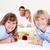 Jolly family having breakfast sitting on bed at home stock photo © wavebreak_media