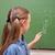 iskolás · lány · mutat · villanykörte · iskolatábla · iskola · háttér - stock fotó © wavebreak_media
