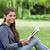 jungen · lächelnd · Mädchen · halten · Buch · Sitzung - stock foto © wavebreak_media