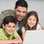 Smiling father with kids using laptop in kitchen stock photo © wavebreak_media