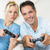 cheerful couple playing video games in living room stock photo © wavebreak_media