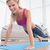 strong blonde in plank position on exercise mat smiling at camer stock photo © wavebreak_media