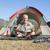 happy camper looking at map sitting in his tent stock photo © wavebreak_media