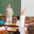 pupils raising their hands during class stock photo © wavebreak_media