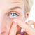 pretty blonde applying contact lens stock photo © wavebreak_media