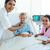 female doctor and nurse examining a patient stock photo © wavebreak_media