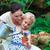 jonge · familie · voorjaar · tuin · gelukkig · gezin - stockfoto © wavebreak_media