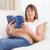 feliz · mulher · grávida · leitura · livro · olhando · câmera - foto stock © wavebreak_media