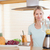 femme · souriante · fraise · cuisine · vert · électriques - photo stock © wavebreak_media