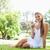 glimlachend · jonge · vrouw · vergadering · gras · park · bloem - stockfoto © wavebreak_media