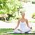 genç · kadın · oturma · yoga · pozisyon · park · güzellik - stok fotoğraf © wavebreak_media
