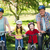 boldog · család · bicikli · park · napos · idő · nő · tavasz - stock fotó © wavebreak_media