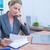 Pretty blonde businesswoman phoning and using her laptop stock photo © wavebreak_media