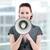Confident businesswoman yelling through a megaphone stock photo © wavebreak_media