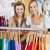 Bright female friends doing shopping smiling at the camera in a clothes store stock photo © wavebreak_media
