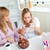 Delighted female friends eating a chocolate cake in the kitchen at home stock photo © wavebreak_media