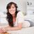 ブルネット · 女性 · ヘッドホン · カーペット · リビングルーム - ストックフォト © wavebreak_media