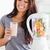 good looking woman using a blender while holding a drink in the kitchen stock photo © wavebreak_media