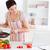 güzel · bir · kadın · pişirme · makbuz · dizüstü · bilgisayar · mutfak · ev - stok fotoğraf © wavebreak_media